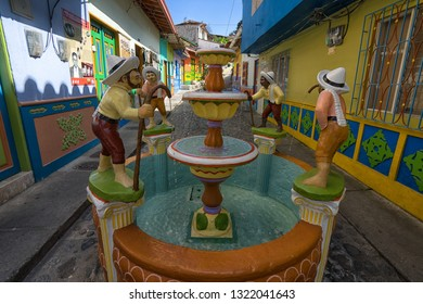 Guatape, Colombia - August 29, 2018: statues decorating the street of the popular tourist destination town