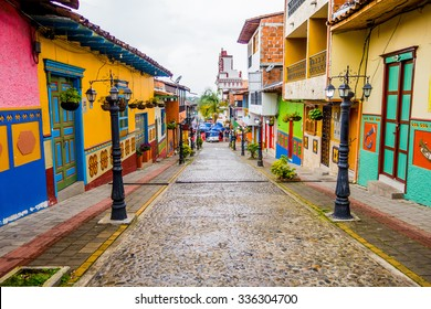 GUATAPE, COLOMBIA - FEBRUARY 7, 2015: Beautiful and colorful streets in Guatape city center, known as town of Zocalos, with beautifully carved and decorated 3d motifs
