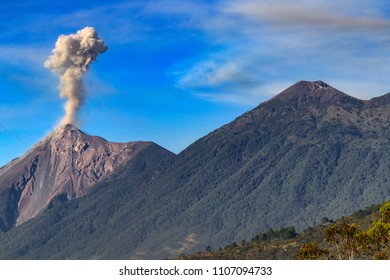 Guatemala. Antigua. Smoky, active Fuego volcano (Volcan Fuego) and dormant Acatenango
