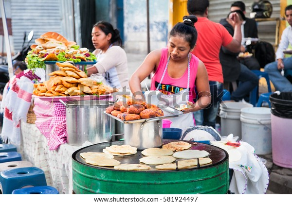 GUATEMALA CITY, GUATEMALA-DEC 25, 2015: Mayan women sell   Guatemalan food  at the street of Guatemala city on Dec 25 2015. Guatemala.