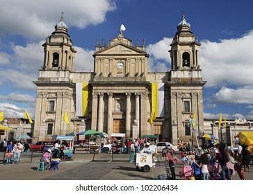 GUATEMALA CITY, GUATEMALA-JAN 3: Activity in front of the Guatemala Metropolitan Cathedral in Plaza Mayor on Jan 3, 2012.  This is the main church of Guatemala City and of the Archdiocese of Guatemala