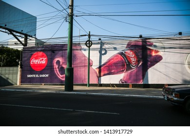 Guatemala City, Guatemala - January 7 2017: A sign for Coca Cola in a glass bottle.