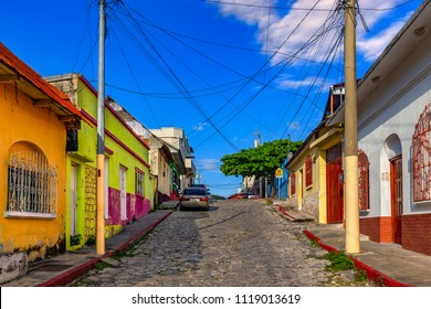 Guatemala. Flores, El Peten. The old part of the city in colonial style with narrow cobblestone streets, red-roofed buildings and pastel houses