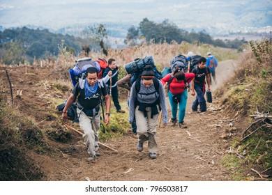 GUATEMALA - January 08: Group of hikers getting tired as they ascend the Acatenango Volcano, January 08, 2017 near Antigua, Guatemala