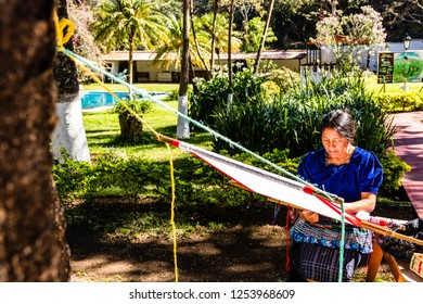 Guatemala, Puerto Quetzal - 2018. Woman weaving in an old village in Guatemala.  Traditional waver from Guatemala.