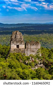 Guatemala. Tikal National Park (UNESCO World Heritage Site since 1979). Temples I and II seen from the top of the Temple IV