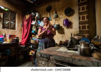 Guatemalan woman making tortillasin San Juan La Laguna, Lake Atitlan, Guatemala