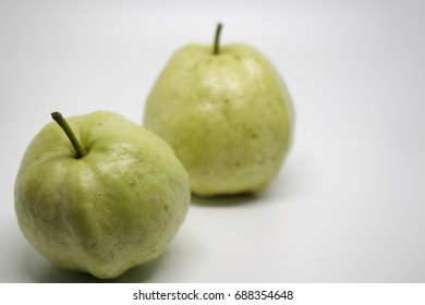 Guava fruit isolated on white background. with selective focus on the left fruit