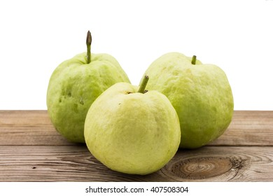 Guava on wooden floor isolate white background