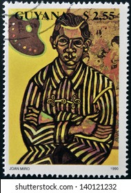 GUAYANA - CIRCA 1990: A stamp printed in Guyana shows Joan Miro Portrait of Enric Cristofol Ricart, MOMA, NYC, circa 1990