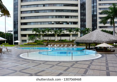 GUAYAQUIL, ECUADOR - FEBRUARY 15, 2017:  Wyndham Hotel Guayaquil Pool. The hotel is situated just steps from the historic Santa Ana Hill and its famous Lighthouse.