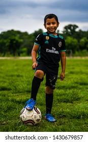 Guazacacan Guatemala 05-25-2019 portrait of latin child in Guatemalan soccer/football