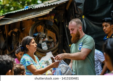 Guazacapan Guatemala 05-15-2019 christian mission team giving aid to family in Guatemalan village