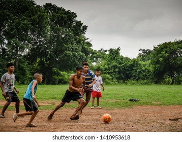 Guazacapan Guatemala 05-15-2019 latin children playing soccer football in Guatemalan village
