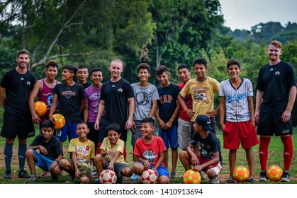Guazacapan Guatemala 05-15-2019 mission team teaching children how to play soccer football in Guatemalan village