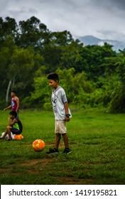 Guazacapan Guatemala 05-20-2019 latin children playing soccer/football in rural Guatemalan village