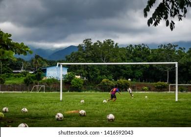 Guazacapan Guatemala 05-27-2019 latin children playing soccer football in Guatemala