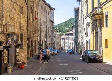 Gubbio, Italy - July 16, 2012: the streets of Gubbio, at Umbria Italy, with a few people and cars parked