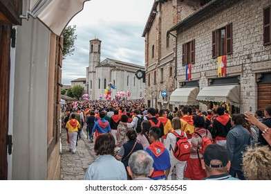 """Gubbio, Italy - May 15, 2013. Colorful crowd participating in the """"Feast of Ceri"""", a traditional event of the city of Gubbio, a well preserved medieval town. Located in Umbria region, central Italy"""