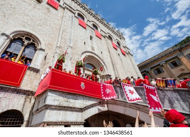 GUBBIO, ITALY - MAY 15 2016 - The trumpeters fanfare welcomes the Ceri into the square to celebrate the annual Festa dei Ceri.