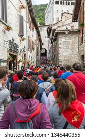 GUBBIO, ITALY - MAY 15 2016 - Crowds make their way up the narrow streets in Gubbio towards Piazza Grande to watch and celebrate the annual Festa dei Ceri