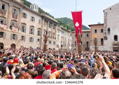 GUBBIO, ITALY - MAY 15 2016 - The Ceri start to race around the Piazza Grande as the crowd look on at the annual Festa dei Ceri.