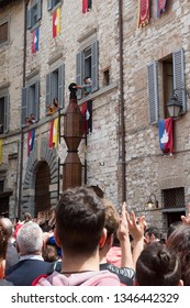 GUBBIO, ITALY - MAY 15 2016 - The Saint Antonio Ceri is blessed by a nun is it is pararded around the city of Gubbio at the annual Festa dei Ceri.