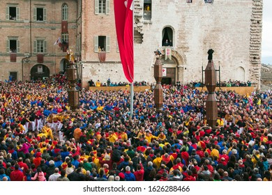GUBBIO, ITALY - MAY 15, 2017: View of the Corsa dei Ceri or the candle race in the main square (Piazza della Signoria) of Gubbio with many tourists