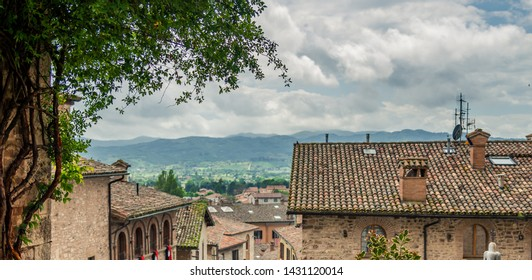 Gubbio, Italy - May 21 2019: View of the medieval city of Gubbio in the summer day, Umbria in Italy.