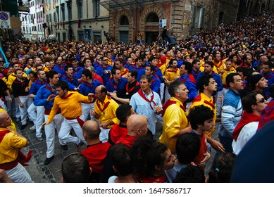 GUBBIO,ITALY-MAY 15: Colorful crowd participating in the 'Feast of Ceri', a traditional event of the city of Gubbio, a well preserved medieval townon the 15th of may 2008 in Gubbio.