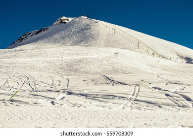 Gudauri - paradise for freeride. Winter mountains background with ski slopes and ski lifts. Skiing resort. Extreme sport. Active holiday. Tourism industry, travel concept.