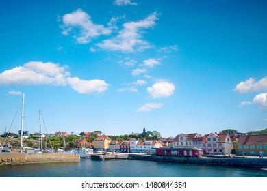GUDHJEM, DENMARK - JUNE 30 - 2019: Gudhjem harbor on the danish island of Bornholm in the summer