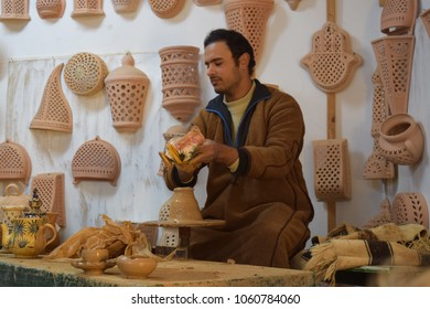 GUELLALA, DJERBA, TUNISIA - JANUARY 3 2017: Master of Ceramic Cookware. Guellala berber town in the south of Djerba island in Tunisia. Northern Africa