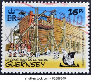 GUERNSEY - CIRCA 1992 : stamp printed in Guernsey shows bullet in the construction of an Egyptian ship, belonging to the comic Asterix and Obelix, circa 1992