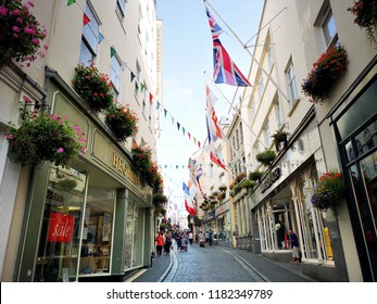 Guernsey, UK: August 25, 2018: The Old Quarter with quaint shops selling gifts and souvenirs. Guernsey is one of the Channel Islands in the English Channel near the French coast.