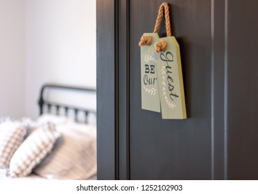 """Guest bedroom - open door with sign that says """"Be our guest"""""""
