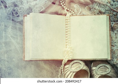Guest book with wedding dress, shoes, pearl