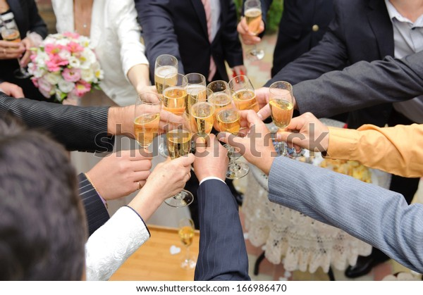 guest clanging glasses at wedding party