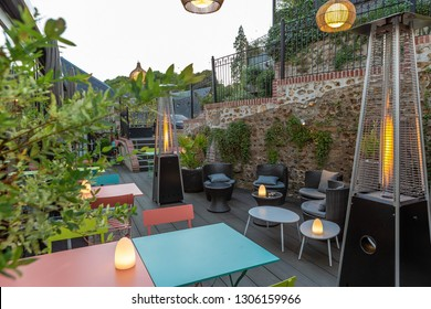 guest house, garden restaurant, color metal tables and outdoor lounge with floral decorations, gaz heating system,