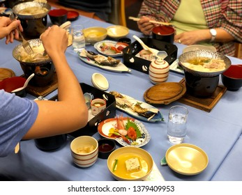 Guest of Japanese Ryokan style while have traditional Kaiseki dinner set with sashimi, grilled fish, tofu and variety tasty food.
