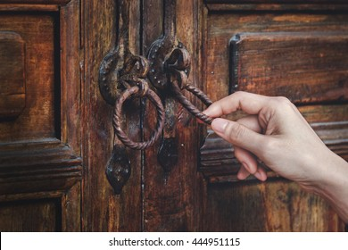Guest Knocking Wooden Traditional Door, in front of the House