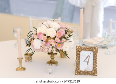 Guest numbered table with with adorable bouquet, closeup