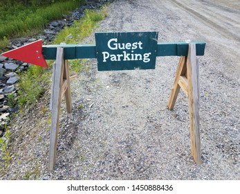 guest parking sign with red arrow and gravel