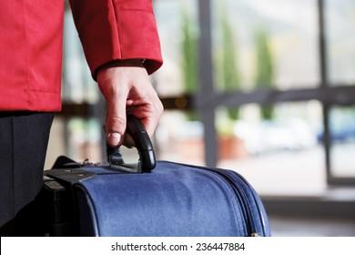 Guest receiving help from hotel bellhop.