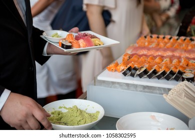 Guest with Sushi buffet bar, Food Buffet Catering Dining Eating Party Sharing Concept in luxury Japanese food restaurant, Service at business meeting, weddings or event.