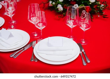 Guest table on wedding ceremony, decorated with bouquet and settings