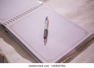 guestbook book pen