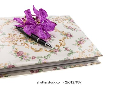 guestbook and pen decorating with pink mokara orchid