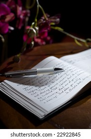 Guest-book with 'thank you' notes and orchids