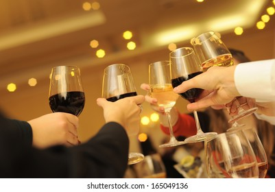 Guests celebration with wine glasses.